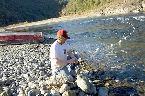 Ferris fishes for salmon with gill nets near the Tish Tang campground in Hoopa River